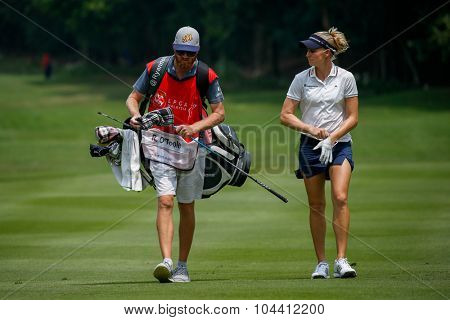 KUALA LUMPUR, MALAYSIA - OCTOBER 09, 2015: USA's Ryan O'Toole discusses with her caddy on the sixth hole fairway of the KL Golf & Country Club at the 2015 Sime Darby LPGA Malaysia golf tournament.