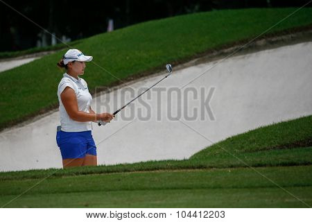 KUALA LUMPUR, MALAYSIA - OCTOBER 09, 2015: South Korea's Mirim Lee plays from 6th hole sand bunker of the Kuala Lumpur Golf & Country Club at the 2015 Sime Darby LPGA Malaysia golf tournament.