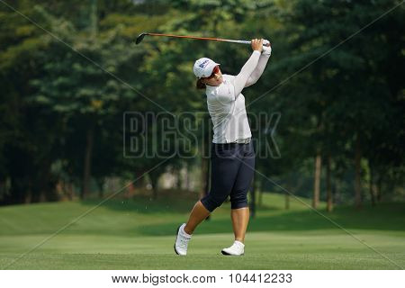 KUALA LUMPUR, MALAYSIA - OCTOBER 09, 2015: South Korea's Amy Yang plays her shot from the sixth hole fairway of the KL Golf & Country Club at the 2015 Sime Darby LPGA Malaysia golf tournament.