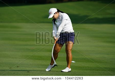 KUALA LUMPUR, MALAYSIA - OCTOBER 09, 2015: Thailand's Moriya Jutanugarn hits from 6th hole fairway at the Kuala Lumpur of the  Golf & Country Club at the 2015 Sime Darby LPGA Malaysia golf tournament.