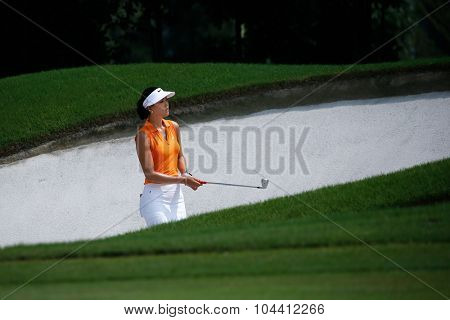 KUALA LUMPUR, MALAYSIA - OCTOBER 09, 2015: USA's Michelle Wie plays her shot from the sixth hole sand bunker of the KL Golf & Country Club at the 2015 Sime Darby LPGA Malaysia golf tournament.