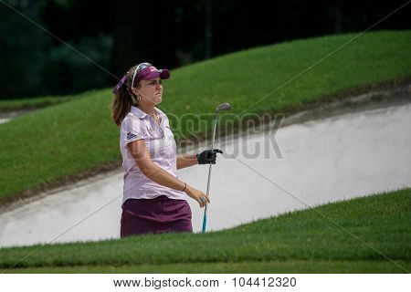 KUALA LUMPUR, MALAYSIA - OCTOBER 09, 2015: USA's Lexi Thompson plays her shot from the sixth hole bunker of the Kuala Lumpur Golf & Country Club at the 2015 Sime Darby LPGA Malaysia golf tournament.