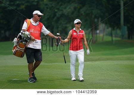 KUALA LUMPUR, MALAYSIA - OCTOBER 09, 2015: South Korea's Sei Young Kim takes a club on the sixth hole fairway of the KL Golf & Country Club at the 2015 Sime Darby LPGA Malaysia golf tournament.
