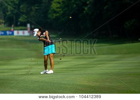 KUALA LUMPUR, MALAYSIA - OCTOBER 09, 2015: South Korea's Mi Hyang Lee plays from 6th hole fairway of the Kuala Lumpur Golf & Country Club at the 2015 Sime Darby LPGA Malaysia golf tournament.