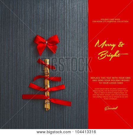 conceptual handmade christmas tree , made with wood and red ribbons