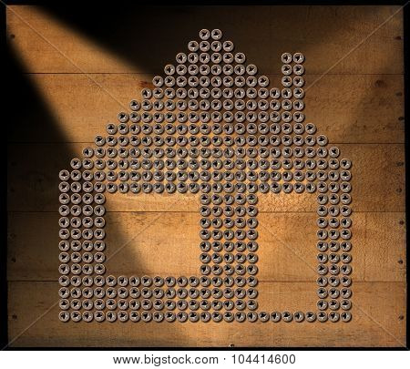 House Symbol - Screws On Wooden Background