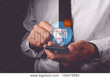 Businessman Viewing E-mail On Mobile Smartphone