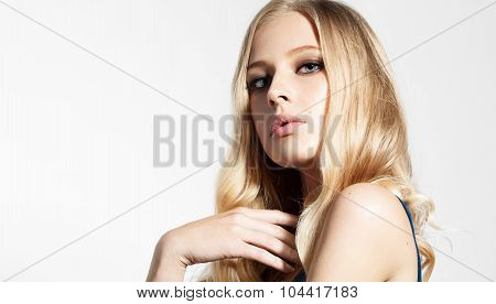 Close-up Face Of A Beautiful Woman With Blond Hair Shining On A White Background