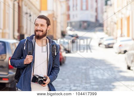 Handsome young man is traveling across city