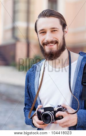 Attractive bearded man is traveling across town