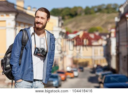Handsome young guy is making journey across town