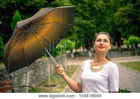 Girl With Umbrella Looking At The Sky