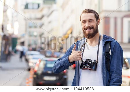 Cheerful young hipster guy is traveling across town