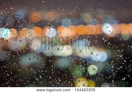 Rainwater droplet on the window with blurred bokeh background