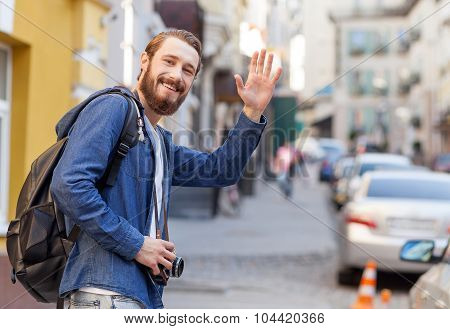 Attractive young man is making journey across town