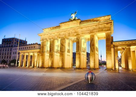 Floodlit Brandenburg Gate In Berlin - Symbol Of Germany.