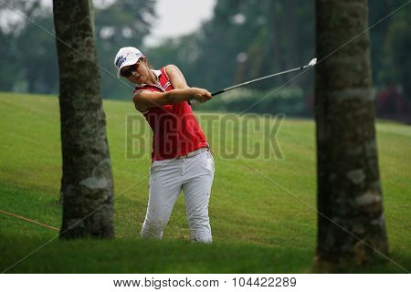 KUALA LUMPUR, MALAYSIA - OCTOBER 09, 2015: South Korea's Sei Young Kim hits from the rough of the 6th hole fairway at the KL Golf & Country Club at the 2015 Sime Darby LPGA Malaysia golf tournament.