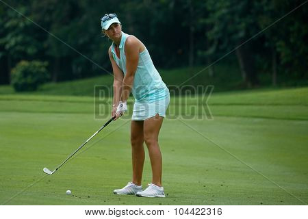 KUALA LUMPUR, MALAYSIA - OCTOBER 09, 2015: Sweden's Anna Nordqvist prepares to play from the 6th hole fairway at the KL Golf & Country Club at the 2015 Sime Darby LPGA Malaysia golf tournament.