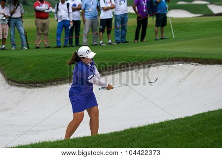 KUALA LUMPUR, MALAYSIA - OCTOBER 09, 2015: South Korea's Inbee Park plays out of the sand bunker of the 18th hole of the KL Golf & Country Club at the 2015 Sime Darby LPGA Malaysia golf tournament.