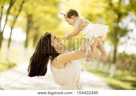 Mother And Baby In The Summer Park