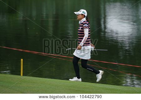 KUALA LUMPUR, MALAYSIA - OCTOBER 09, 2015: Japan's Sakura Yokomine walks to the 18th hole green at the KL Golf & Country Club at the 2015 Sime Darby LPGA Malaysia golf tournament.