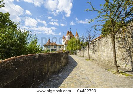 A Cobbled Road Leads To The Castle Thun