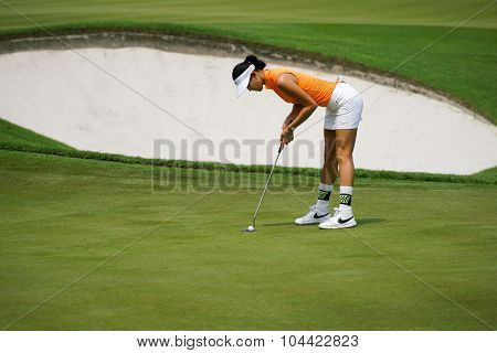 KUALA LUMPUR, MALAYSIA - OCTOBER 09, 2015: USA's Michelle Wie putts at the 18th hole green at the KL Golf & Country Club at the 2015 Sime Darby LPGA Malaysia golf tournament.