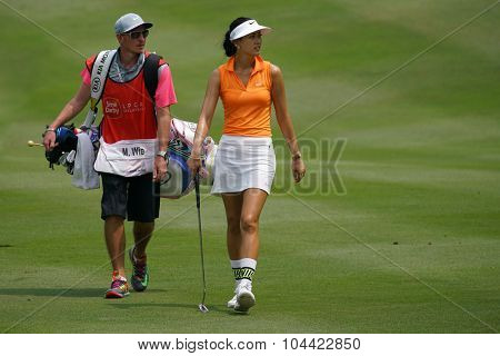 KUALA LUMPUR, MALAYSIA - OCTOBER 09, 2015: USA's Michelle Wie walks to the 18th hole green at the KL Golf & Country Club at the 2015 Sime Darby LPGA Malaysia golf tournament.