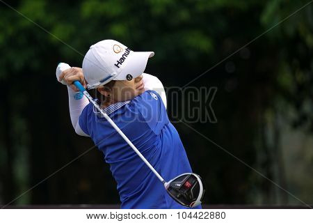 KUALA LUMPUR, MALAYSIA - OCTOBER 10, 2015: South Korea's Eun Hee Ji tees off at the sixth hole of the KL Golf & Country Club on Round 3 day at the 2015 Sime Darby LPGA Malaysia golf tournament.