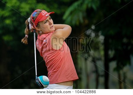 KUALA LUMPUR, MALAYSIA - OCTOBER 10, 2015: USA's Lexi Thompson tees off at the sixth hole of the KL Golf & Country Club on Round 3 day at the 2015 Sime Darby LPGA Malaysia golf tournament.