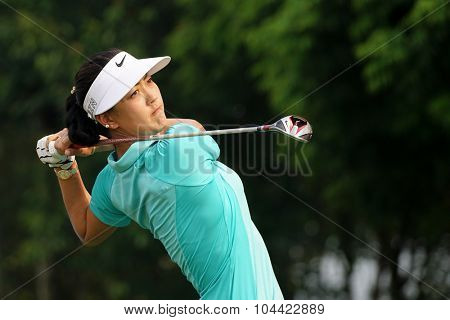 KUALA LUMPUR, MALAYSIA - OCTOBER 10, 2015: USA's Michelle Wie tees off at the sixth hole of the KL Golf & Country Club on Round 3 day at the 2015 Sime Darby LPGA Malaysia golf tournament.