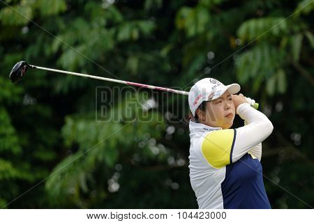 KUALA LUMPUR, MALAYSIA - OCTOBER 10, 2015: China's Shanshan Feng tees off at the sixth hole of the KL Golf & Country Club on Round 3 day at the 2015 Sime Darby LPGA Malaysia golf tournament.