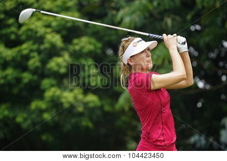 KUALA LUMPUR, MALAYSIA - OCTOBER 10, 2015: USA's Sydney Michaels tees off at the sixth hole of the KL Golf & Country Club on Round 3 day at the 2015 Sime Darby LPGA Malaysia golf tournament.