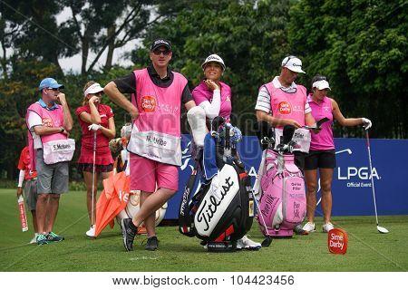 KUALA LUMPUR, MALAYSIA - OCTOBER 10, 2015: LPGA golfers wait to tee off at the sixth hole of the KL Golf & Country Club at the 2015 Sime Darby LPGA Malaysia golf tournament.