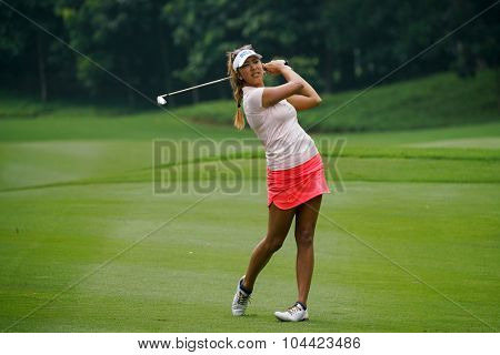 KUALA LUMPUR, MALAYSIA - OCTOBER 10, 2015:USA's Alison Lee tees off at the sixth hole of the KL Golf & Country Club on Round 3 day at the 2015 Sime Darby LPGA Malaysia golf tournament.