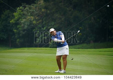 KUALA LUMPUR, MALAYSIA - OCTOBER 10, 2015: South Korea's Inbee Park plays on the fairway of the ninth hole of the KL Golf & Country Club during the 2015 Sime Darby LPGA Malaysia golf tournament.