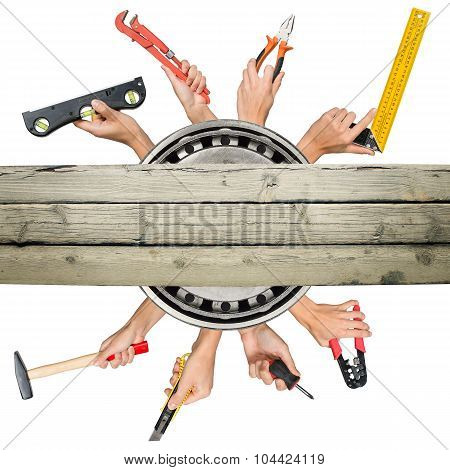 Peoples hands holding tools with deck