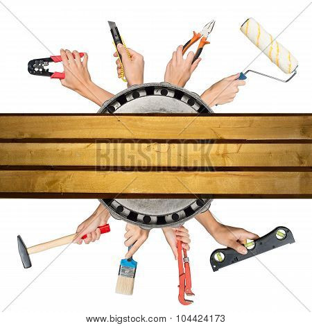 Humans hands holding tools with deck