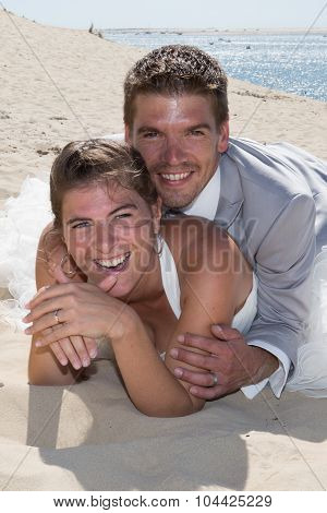 Beautiful Happy Wedding Couple At The Beach Piggy Back