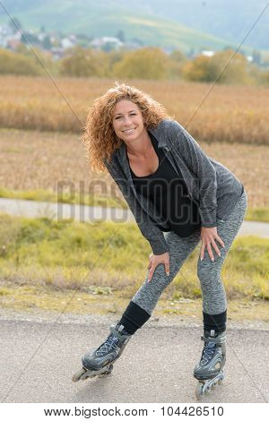Smiling Attractive Young Woman On Roller Blades