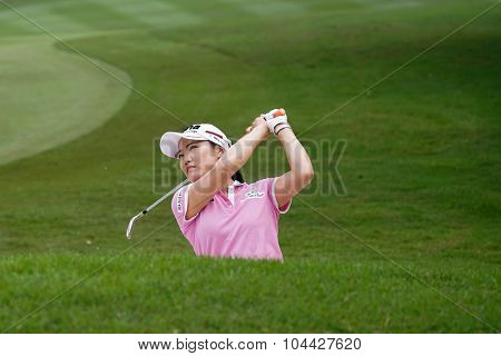 KUALA LUMPUR, MALAYSIA - OCTOBER 10, 2015: South Korea's So Yeon Ryu plays out of the sand trap of the 18th hole of the KL Golf & Country Club during the 2015 Sime Darby LPGA Malaysia golf tournament.