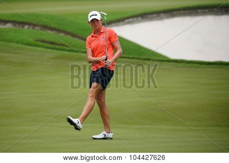 KUALA LUMPUR, MALAYSIA - OCTOBER 10, 2015: USA's Stacy Lewis reacts after he putt on the green of the 18th hole of the KL Golf & Country Club during the 2015 Sime Darby LPGA Malaysia golf tournament.