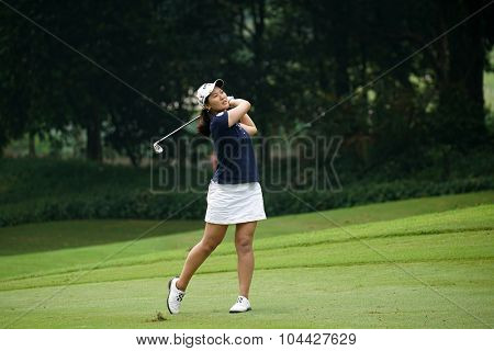 KUALA LUMPUR, MALAYSIA - OCTOBER 10, 2015: China's Xi Yu Lin plays on the fairway of the ninth hole of the KL Golf & Country Club during the 2015 Sime Darby LPGA Malaysia golf tournament.