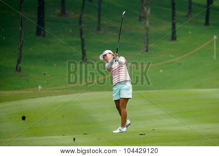 KUALA LUMPUR, MALAYSIA - OCTOBER 10, 2015: South Korea's In Kyung Kim plays on the 18th hole fairway of the KL Golf & Country Club during the 2015 Sime Darby LPGA Malaysia golf tournament.