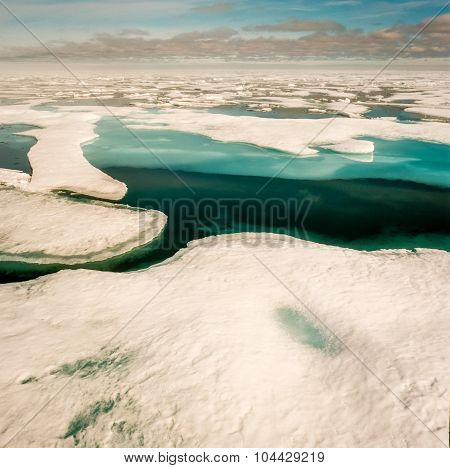 Deep blue ice sheets melt in the Arctic