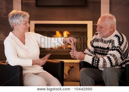 Senior Couple Playing On Winter Night