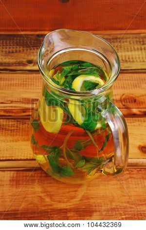hot tea with mint on wooden table