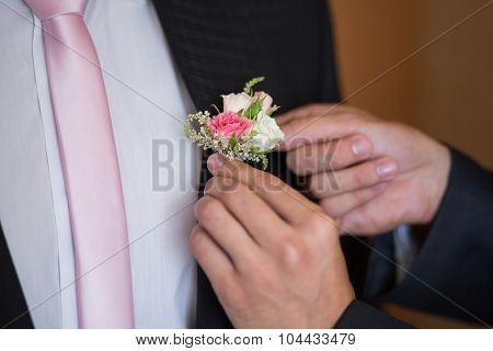 Boutonniere On Trendy Groom At Wedding