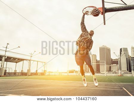 Street Basketball Player Performing Power Slum Dunk