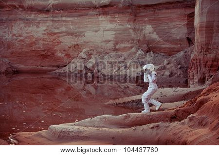Water on Mars, futuristic astronaut, image with the effect of toning
